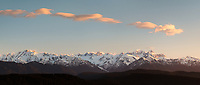 Southern Alps with its highest peaks of Aoraki, Mount Cook and Mount Tasman. Franz Josef Glacier on left, Westland Tai Poutini National Park, UNESCO World Heritage Area, West Coast, New Zealand, NZ