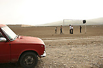 Boys play soccer on a field at the Chalabixan settlement for people displaced from Nagorno-Karabakh, located near Sheki, Azerbaijan, on Wednesday, Nov. 2, 2005.
