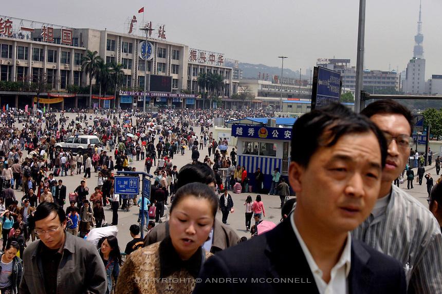Guangzhou, population 6 million. Crowds swarm around Guangzhou's train station.