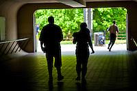 Commuters rushing to waiting buses, Shady Grovr Metro, Gaithersburg, Maryland.