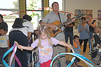 Michael Cladis entertains children during the MLK Kidz Party at Virginia Avenue park on Saturday, January 15, 2011.
