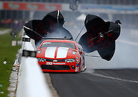 Apr 29, 2016; Baytown, TX, USA; NHRA  pro mod driver Jonathan Gray loses control and hits the wall after blowing a rear tire during qualifying for the Spring Nationals at Royal Purple Raceway. Gray was uninjured. Mandatory Credit: Mark J. Rebilas-USA TODAY Sports