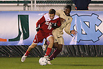 13 November 2009: NC State's Chris Zuerner (19) and Boston College's Edvin Worley (behind). The North Carolina State University Wolfpack defeated the Boston College Eagles 1-0 at WakeMed Stadium in Cary, North Carolina in an Atlantic Coast Conference Men's Soccer Tournament Semifinal game.