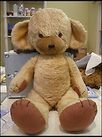 BNPS.co.uk (01202 558833)<br /> Pic: AlicesBearShop/BNPS<br /> <br /> Mrs Walker's bear after surgery.<br /> <br /> Broken bears and deteriorating dolls from all over the world are being brought back to life by a UK team of dedicated doctors and nurses at one of the last remaining toy hospitals.<br /> <br /> The team at Alice's Bear Shop, a teddy bear and doll hospital in Lyme Regis, Dorset, perform all kinds of 'surgery' from simple restringing and re-stuffing to head re-attachments and complete skin grafts.<br /> <br /> Rikey Austin, 49, opened the hospital in January 2000 but also ran a shop and only repaired one or two toys a month.<br /> <br /> Now she has a four-month waiting list for patients and has had to close the shop to focus on the hospital side of the business.