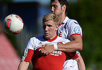 FUSSBALL  DFB POKAL        SAISON 2012/2013 SpVgg Unterchaching - 1. FC Koeln  18.08.2012 Andreas Voglsammer (li, Unterhaching) GEGEN Kevin Pezzoni (1. FC Koeln)