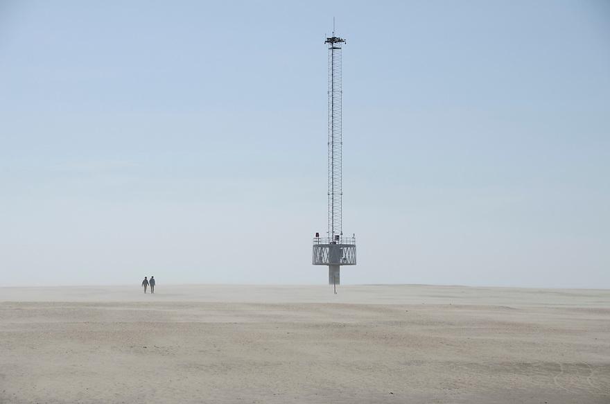 12april2015<br /> De zandmotor bij Monster. Meettoren op de zandvlakte, het zand waait bij een straffe wind.<br /> <br /> (c)renee teunis