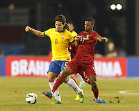 Brazil substitute midfielder Hernanes (8) dribbles as Portugal forward Nani (17) defends. In an international friendly, Brazil (yellow/blue) defeated Portugal (red), 3-1, at Gillette Stadium on September 10, 2013.