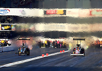Nov 8, 2013; Pomona, CA, USA; NHRA top fuel dragster driver Clay Millican (right) races alongside Troy Buff during qualifying for the Auto Club Finals at Auto Club Raceway at Pomona. Mandatory Credit: Mark J. Rebilas-