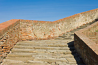 A weathered staircase leading to a local cathederal.