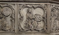 Detail of bas-relief sculpture, mid 13th century, on the base of the portal of the Upper chapel of La Sainte-Chapelle, Paris, France. One of a series of reliefs illustrating scenes from the Old Testament book of Genesis. Here we see God creating the animals. Each panel has a decorated curly frame with mythical beasts in the corner. Sainte Chapelle was built 1239-48 to house King Louis IX's collection of Holy Relics. It is a UNESCO World Heritage Site. Picture by Manuel Cohen.