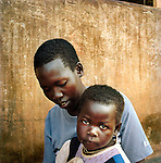 Anna 19. Spend 10 years in the LRA. The rebels took many of the children to their bases outside of Uganda in Sudan, where there are frequent famines. 'Some years were particularly bad, we would be walking and people would just collapse, we would leave them to die and just continue, because we were to weak to pick them up. When it was worst the rebel leaders would take all the food, leave the rest of us to starve, so many people died' Anna escaped during a government attack...Women and Children who were abducted by the Lord's resistance army in Save the children supported  Gusco rehabilitation centre in Gulu, North Uganda.