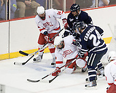 Riley Nash (Cornell - 14), Damon Kipp (UNH - 4), Dan Nicholls (Cornell - 29), Matt Campanale (UNH - 24) - The University of New Hampshire Wildcats defeated the Cornell University Big Red 6-2 (EN) on Friday, March 26, 2010, in their NCAA East Regional semi-final at the Times Union Center in Albany, New York.
