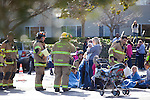 The Santa Clara County Fire Department evacuated Union Presbyterian Church in Los Altos Dec. 12 after reports of a natural-gas leak.  Children are examined by members of the Santa Clara County Fire team, above.  Four students were taken by ambulance to a local hospital as a precautionary measure.<br />