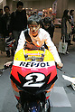 Mar 26, 2010 - Tokyo, Japan - A visitor sits on a racing Honda model during the 37th Tokyo Motorcycle Show at Tokyo Big Sight on March 26, 2010. The event is the Japan's largest motorcycle exhibition and it will be held until March 28 this year. (Photo Laurent Benchana/Nippon News)