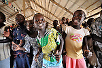 Children dance and sing with enthusiasm during Sunday morning worship at the United Methodist Church in Yei, a town in Central Equatoria State in Southern Sudan.