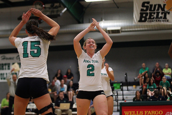 Denton, TX - SEPTEMBER 23: Analisse Shannon #15 of the University of North Texas Mean Green Volleyball and May Allen #2 celebrate a point scored against the University of Louisiana at Monroe at University of North Texas Volleyball Complex in Denton on September 23, 2012 in Denton, Texas. (Photo by Rick Yeatts)