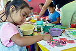 Evelyn Garcia Aguilar creates a painting during an arts and crafts session of the early intervention program of Piña Palmera, a center for community based rehabilitation for people living with disabilities in Zipolite, a town in Oaxaca, Mexico. The 4-year old girl is deaf.