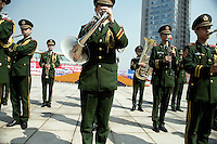 An Army band performs in a public square at the Keqiao World Trade Center in Keqiao, Shaoxing County, Zhejiang, China, before the Keqiao International Textiles, Fabrics & Accessories Exhibition 2008.  Shaoxing County is one of China's biggest producers of textiles.