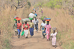 People make their way to market in the village of Nyei, in Southern Sudan. NOTE: In July 2011, Southern Sudan became the independent country of South Sudan