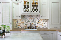 This custom kitchen features a handmade Tamsin mosaic backsplash shown in Calacatta Tia, Verde Luna, Verde Alpi, Giallo Reale, Renaissance Bronze, Rosa Verona, Spring Green, Blue Macaubas and Blue Bahia. As seen in Veranda.<br />
