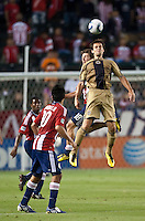 Philadelphia Union defender Jordan Harvey (2) goes high to head the ball from Chivas USA midfielder Blair Gavin (18) during the second half of the game between Chivas USA and the Philadelphia Union at the Home Depot Center in Carson, CA, on July 3, 2010. Chivas USA 1, Philadelphia Union 1.