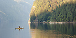 A man is seen kayaking in at the end of Princess Louisa inlet along the coast of British Columbia.