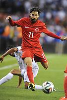 Washington, D.C.- May 29, 2014. Turkey midfielder Olcay Sahan goes against Honduras National Andy Najar  Turkey defeated Honduras 2-0 during an international friendly game at RFK Stadium.