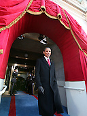Washington, DC - January 20, 2009 -- United States President-elect Barack Hussein Obama walks through an archway at the Capitol and onto the platform where he will be sworn-in as the 44th president of the United States and the first African-American to lead the nation, at the Capitol in Washington, Tuesday, January 20, 2009.     .Credit: J. Scott Applewhite - Pool via CNP