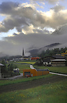 Early morning mist and cloud over farm buildings and church steeple. Imst district, Tyrol/Tirol, Austria, Alps.