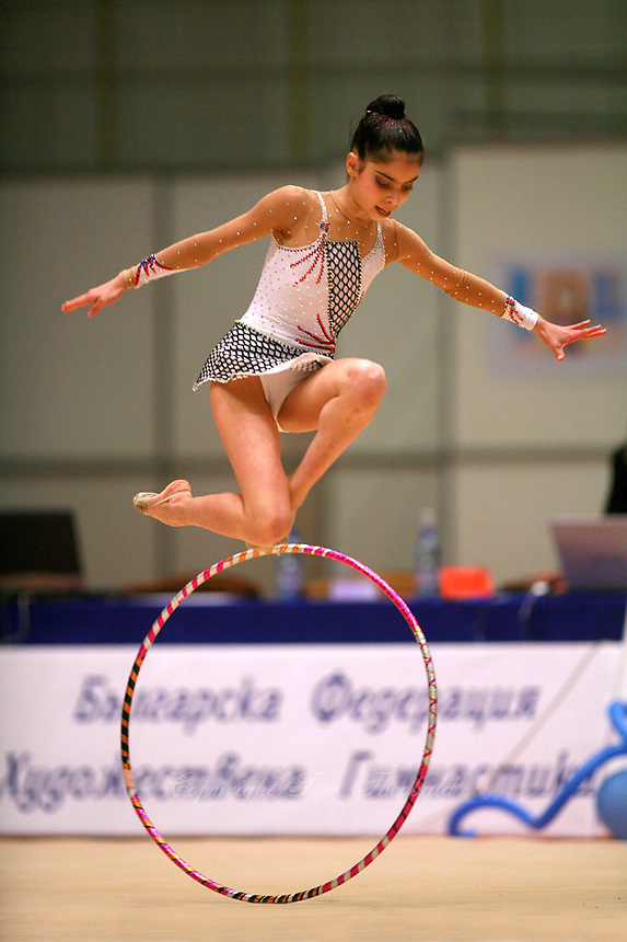 Filipa Siderova of Bulgaria leaps with hoop during gala exhibition at Burgas Grand Prix Rhythmic Gymnastics on May 7, 2006.   (Photo by Tom Theobald)<br />