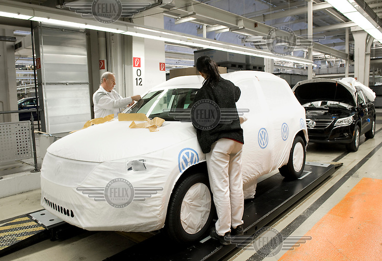 Workers assemble a VW Golf 6 at the Volkswagen car factory in Wolfsburg.