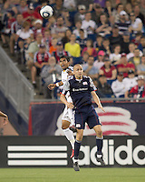Los Angeles Galaxy defender A.J. DeLaGarza (20) and New England Revolution forward Rajko Lekic (10) battle for head ball. In a Major League Soccer (MLS) match, the Los Angeles Galaxy defeated the New England Revolution, 1-0, at Gillette Stadium on May 28, 2011.
