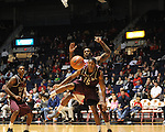 "Arkansas Little Rock's Amos Studivant (15) and Mississippi's Murphy Holloway (31) go for the ball at the C.M. ""Tad"" Smith Coliseum in Oxford, Miss. on Friday, November 16, 2012.]"