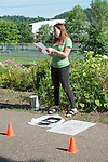 Megan Buskirk, environmental strategies coordinator for Athens City-County Health Department, gives a welcome speech to the volunteers before painting mile markers on the HockHocking Adena Bikeway. ©Ohio University / Photo by Kaitlin Owens