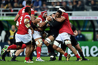 Jerome Kaino of New Zealand takes on the Tonga defence. Rugby World Cup Pool C match between New Zealand and Tonga on October 9, 2015 at St James' Park in Newcastle, England. Photo by: Patrick Khachfe / Onside Images