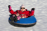 Happy Kid Moving on Otep&auml;&auml; Snowtubing Track, Valga County,  Estonia