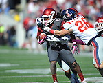 Arkansas wide receiver Keante Minor (15) is tackled by Ole Miss at War Memorial Stadium in Little Rock, Ark. on Saturday, October 27, 2012. Ole Miss won 30-27...