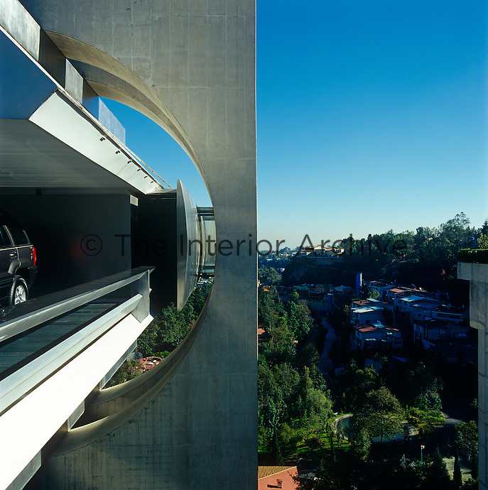 A side view of the Casa En El Aire, a futuristic steel and concrete home overlooking a hillside in Mexico City