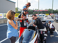 Sep 16, 2016; Concord, NC, USA; Carolina Panthers cornerback Teddy Williams and his son talk with NHRA top fuel driver Steve Torrence during qualifying for the Carolina Nationals at zMax Dragway. Mandatory Credit: Mark J. Rebilas-USA TODAY Sports