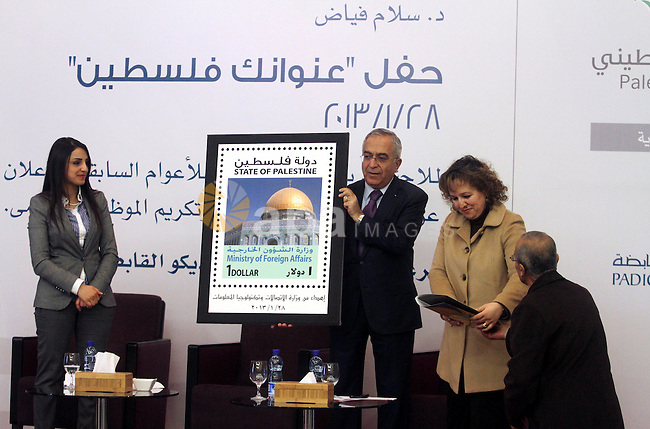 Palestinian prime minister Salam Fayyad participates in the unveiling of the first postage stamp bearing the name of the State of Palestine on January 28, 2013. In the wake of a UN status upgrade last year, the Palestinians are busy printing State of Palestine letterheads and stamps, but they have never been less able to pay their bills. Photo by Issam Rimawi