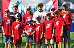 """6 September 2009: Cleveland Indians' utilityman Jamey Carroll poses with kids in the """"Kick-It"""" program designed to unite communities in the fight against pediatric cancer. Carroll played kickball with the kids on the field after a game against the Minnesota Twins at Progressive Field in Cleveland, Ohio. The Indians defeated the Twins 3-1 to take the rubber match of their three-game weekend series. Mandatory Credit: Ed Wolfstein Photo"""