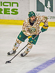 25 November 2014: University of Vermont Catamount Defenseman Alexx Privitera, a Junior from Old Tappan, NJ, in third period action against the University of Massachusetts Minutemen at Gutterson Fieldhouse in Burlington, Vermont. The Cats defeated the Minutemen 3-1 to sweep the 2-game, home-and-away Hockey East Series. The 12th ranked Catamounts wore their camouflage uniforms for the evening to honor the US military. Mandatory Credit: Ed Wolfstein Photo *** RAW (NEF) Image File Available ***