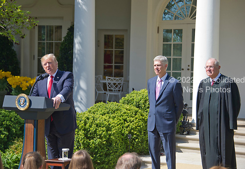 United States President Donald J. Trump, left, makes remarks during the ceremony where Associate Justice of the US Supreme Court Neil Gorsuch, center, will be taking the Oath of Office from Associate Justice Anthony Kennedy, right, in the Rose Garden of the White House in Washington, DC on Monday, April 10, 2017.<br /> Credit: Ron Sachs / CNP<br /> (RESTRICTION: NO New York or New Jersey Newspapers or newspapers within a 75 mile radius of New York City)