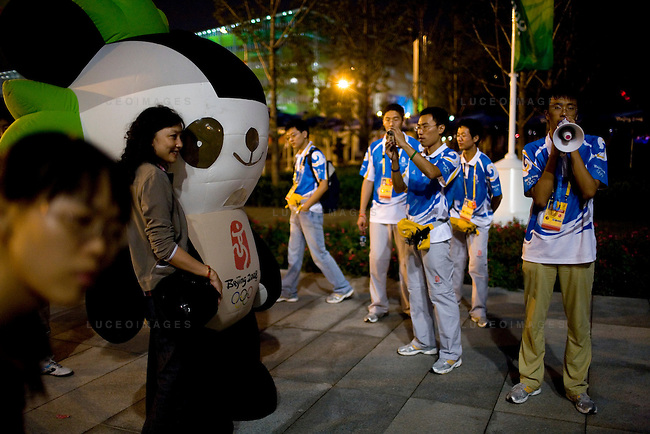 Tourists take photos with one of the Olympic mascots on the Olympic Green in Beijing, China on Thursday, August 21, 2008.  Kevin German