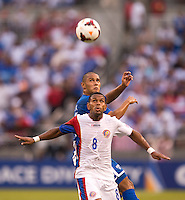 Alexander Lopez (16) of Honduras looks to take the ball away from Kenny Cunningham (8) of Costa Rica during the quarterfinals of the CONCACAF Gold Cup at M&T Bank Stadium in Baltimore, MD.  Honduras defeated Costa Rica, 1-0.