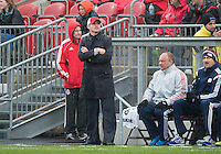 Toronto, Ontario - May 3, 2014: New England Revolution head coach Jay Heaps watches the action during a game between the New England Revolution and Toronto FC at BMO Field.<br /> The New England Revolution won 2-1.