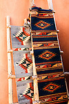 Indian blankets and pueblo style ladder. Santa Fe, New Mexico.
