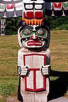 Kwakwaka'wakw (Kwakiutl) Memorial Totem Pole on Namgis Burial Grounds, Alert Bay, Cormorant Island, BC, British Columbia, Canada - Closeup Detail of Man holding Copper