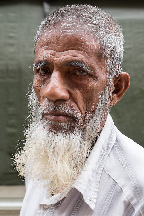 YANGON, MYANMAR - CIRCA DECEMBER 2013: Portrait of an old man in the streets of Yangon
