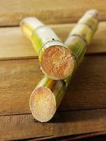 2 sticks of raw sugar cane cut to show the inside
